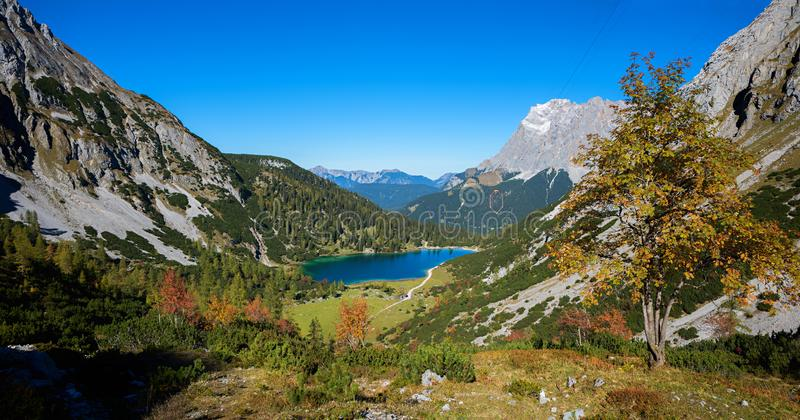 Breathtaking view from the hiking trail to alpine landscape with seebensee and zugspitze mountain in autumn royalty free stock image