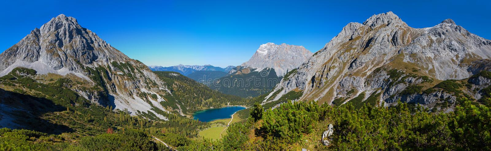 Breathtaking view from the hiking trail to alpine landscape with seebensee and zugspitze mountain royalty free stock photo