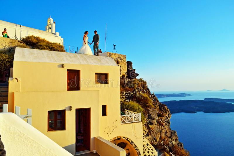 Just married couple on the rooftop Santorini Greece stock photos