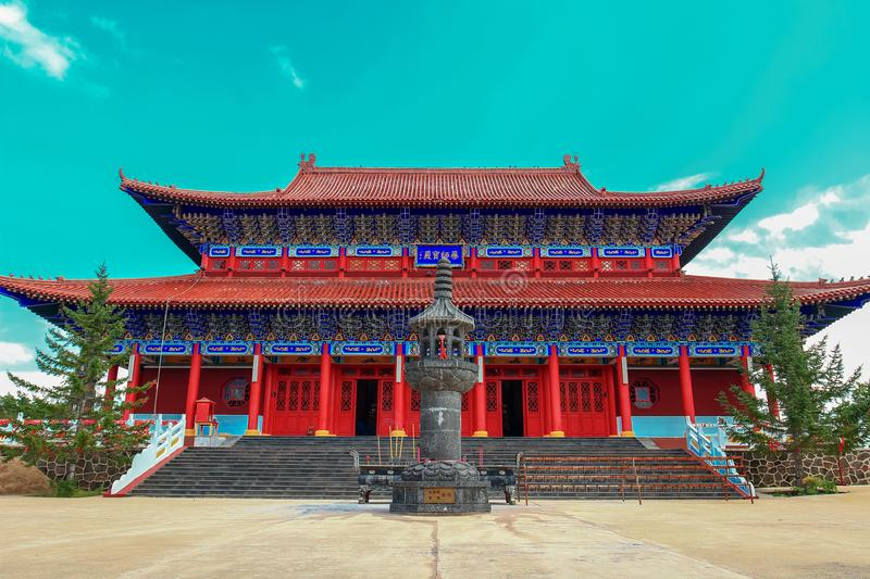 Breathtaking view of king`s palace of Medicine Buddha old temple in Jingpo lake geopark with azure sky royalty free stock image