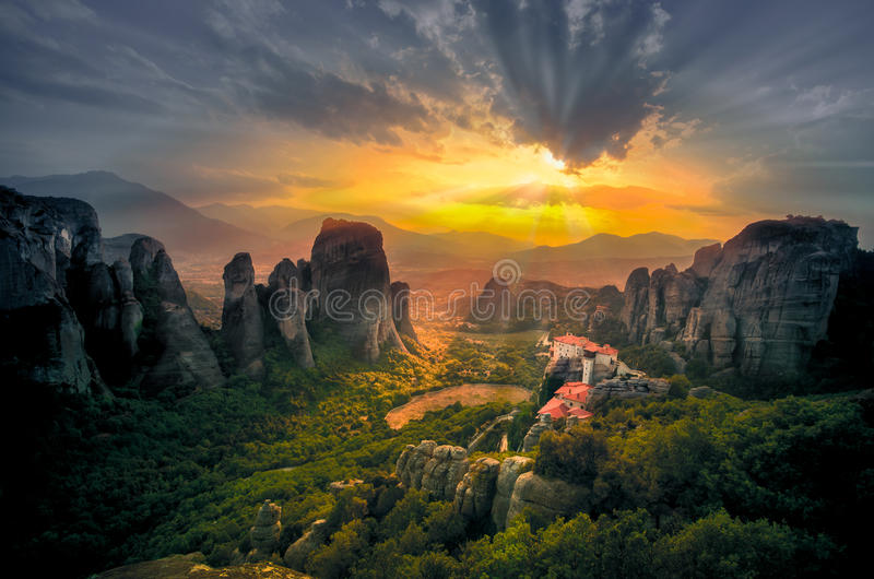 Breathtaking view of Meteora Roussanou Monastery at sunset, Greece. Geological formations of big rocks with Monasteries on top of them royalty free stock photography