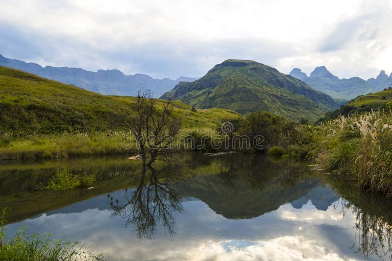 Breathtaking view of the mountains and lake in Drakensberg, South Africa royalty free stock photography