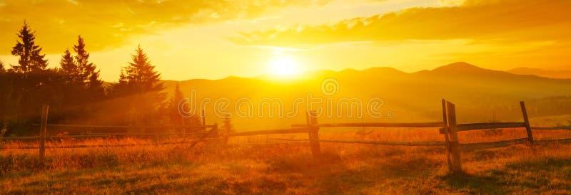Panoramic view of rising sun above mountain ridge royalty free stock image