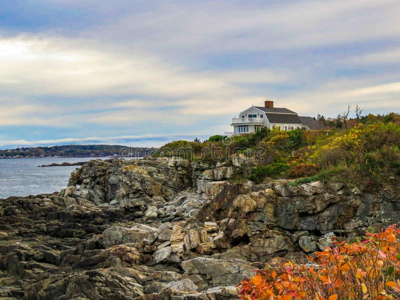 Maine coastal view from Port Elizabeth and the Portland Head Lighthouse. Breathtaking view of the rocky Maine coast and traditional coastal home near the stock images
