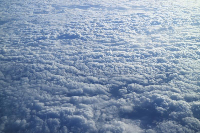 Breathtaking view of the sea of clouds as seen from airplane window during the flight stock photos