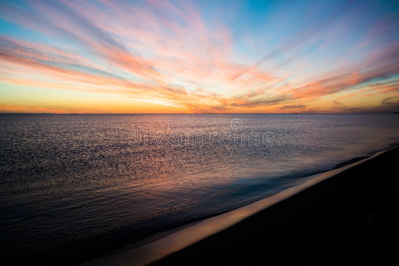 Breathtaking view on sunset over the sea. Looking from the beach. Explosion of colors stock image