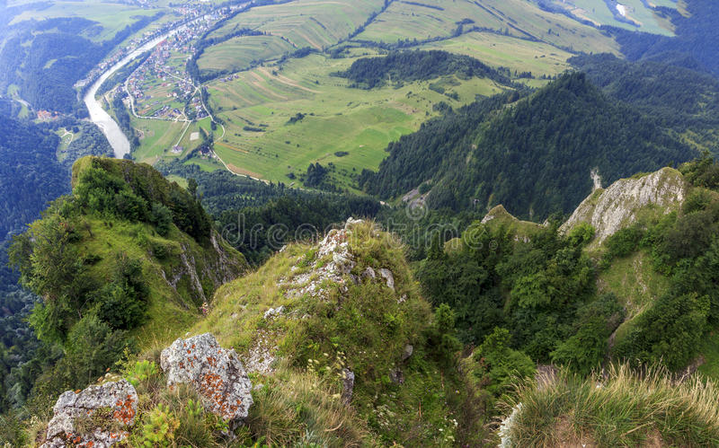 Breathtaking view from Three Crown Mountain, Pieniny. Poland with large vistas of space down below: peaks, forest, meadows, fields and villages royalty free stock image