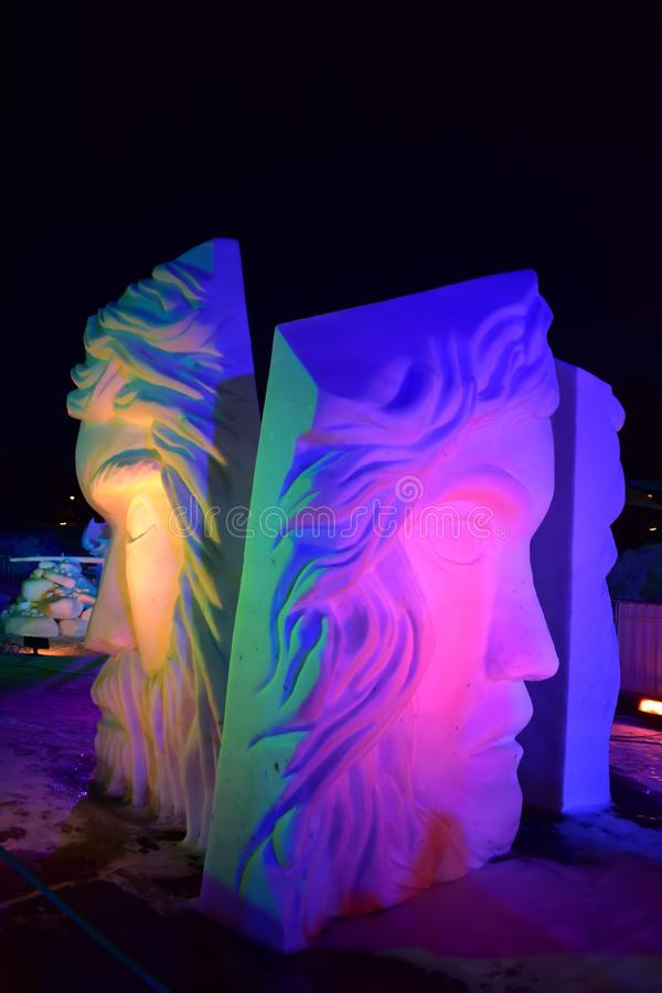 Breckenridge, Colorado, USA: Jan 28, 2018: In Search of Ourselves at Night Snow Sculpture 2018 stock images