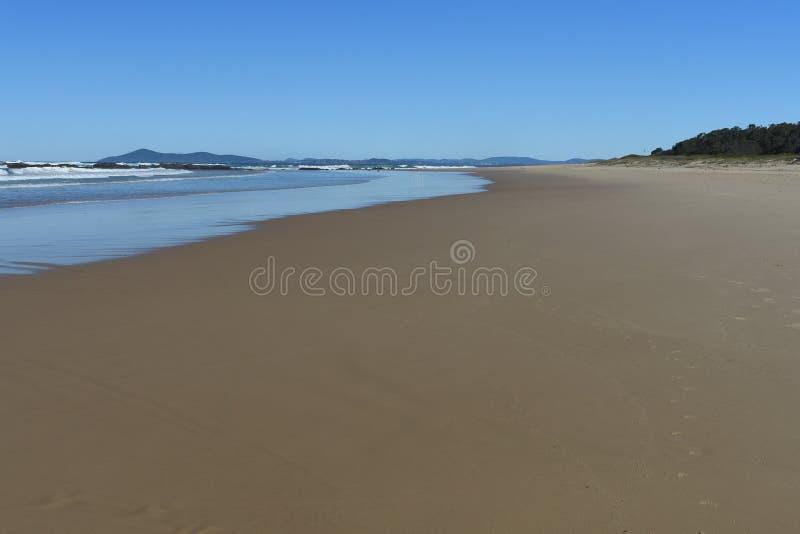 Bred expansiv för Australien för sandig strand strand för baksida kustlinje arkivfoton