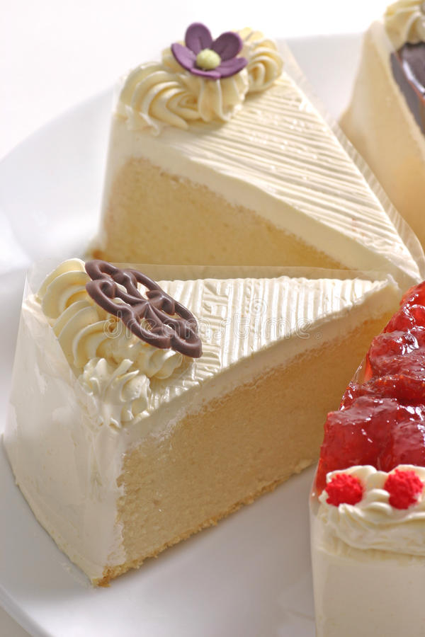 breda smör på cakes fyra arkivbild