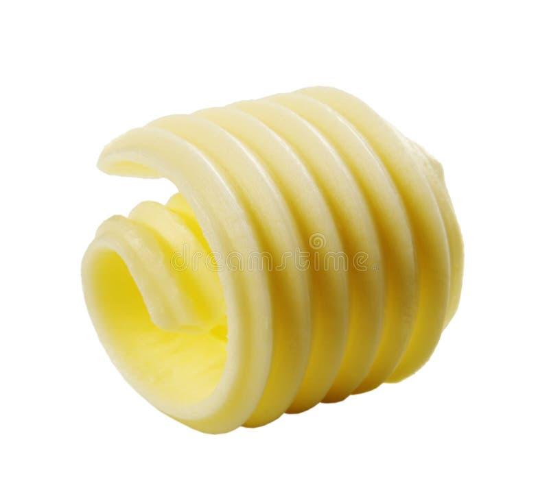 breda smör på krullningen royaltyfri fotografi