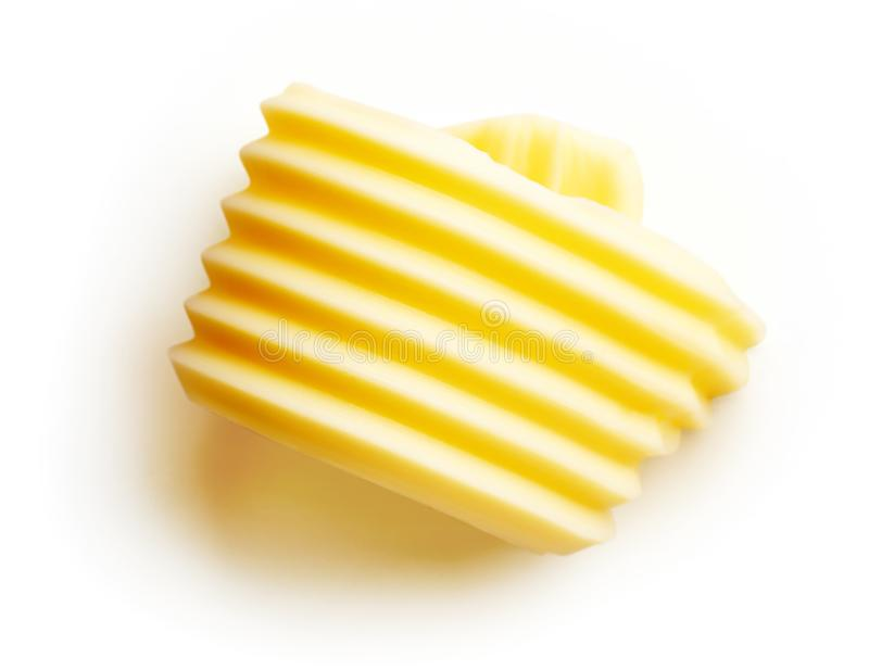 Breda smör på krullningen som isoleras på vit, från över arkivfoton