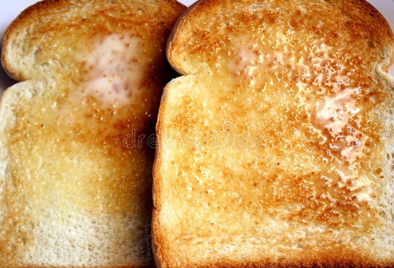 Download Bredd smör på rostat bröd fotografering för bildbyråer. Bild av mealtime - 19791141