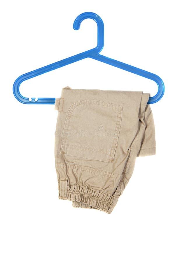 Breeches on hanger. Children's wear - breeches on hanger isolated over white background stock photos