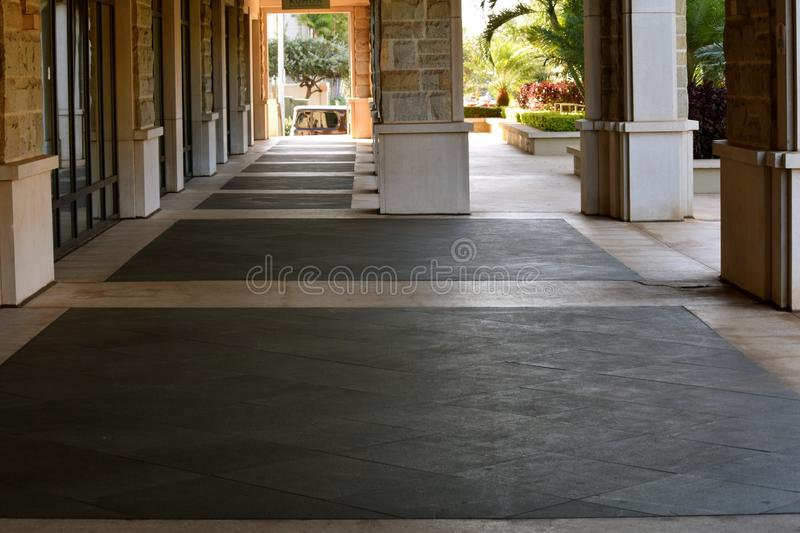 Breezeway. Early morning in a building breezeway stock image