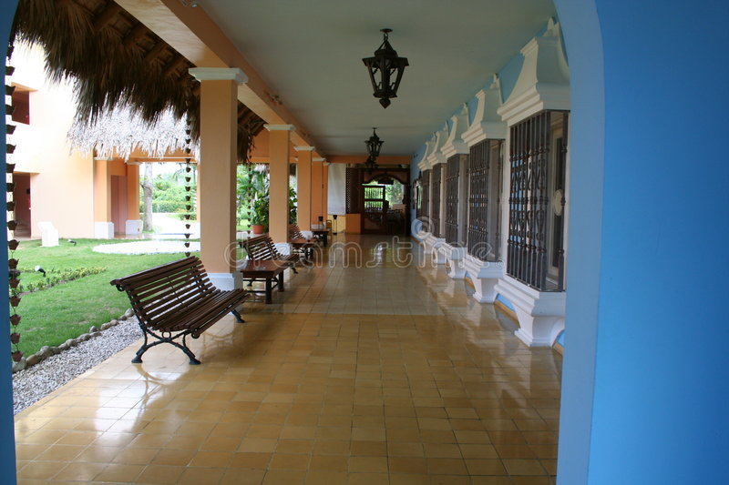 Breezeway at tropical resort. A view of a long, covered breezeway or walkway at a tropical resort stock images