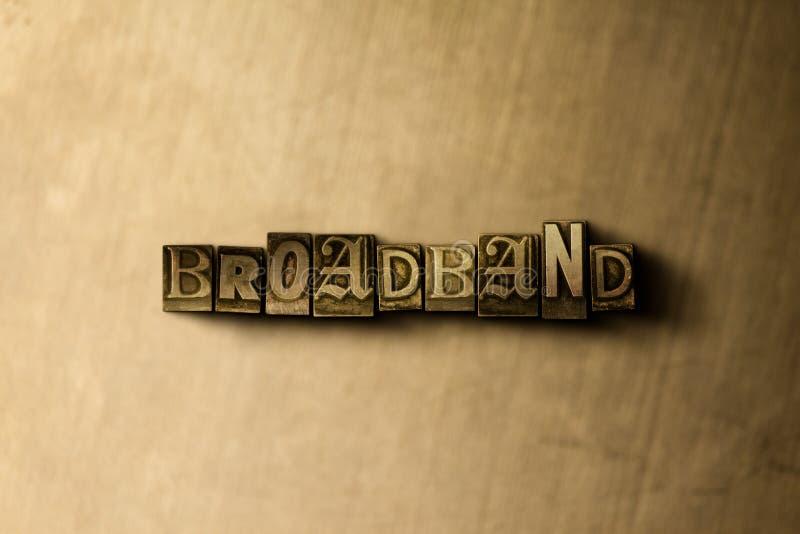 BREITBAND - Nahaufnahme der grungy Weinlese setzte Wort auf Metallhintergrund stock abbildung