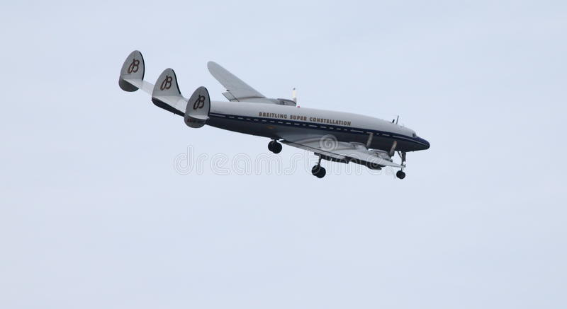 Breitling Lockheed C-121C Super Constellation. Breitling Super Constellation aka Connie coming in to land after performing over the skies of Farnborough during stock photo