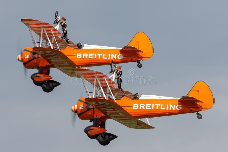 Breitling Wing walkers barnstorming flying display in vintage Boeing Stearman biplanes. Payerne, Switzerland - August 29, 2014: Breitling Wing walkers royalty free stock images
