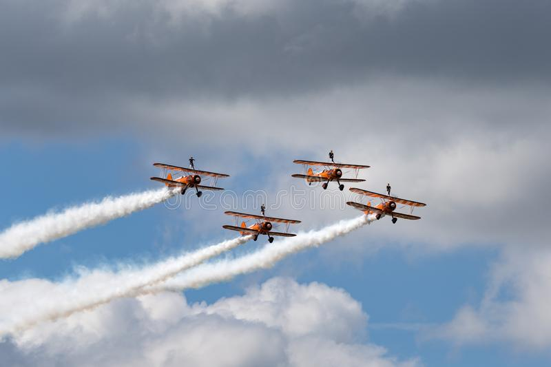 Breitling Wing Walkers Boeing Stearman Biplanes flying in formation. RAF Fairford, Gloucestershire, UK - July 14, 2014: Breitling Wing Walkers Boeing Stearman stock image