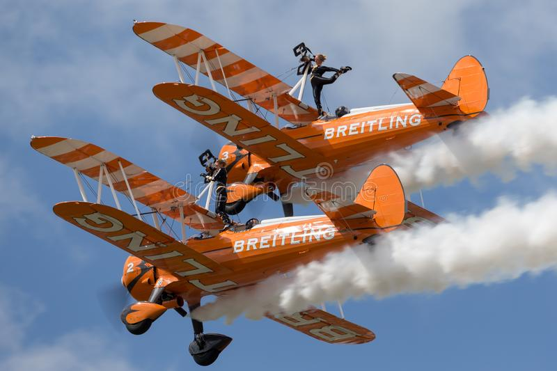 Breitling Wing Walkers Boeing Stearman Biplanes flying in formation. RAF Fairford, Gloucestershire, UK - July 14, 2014: Breitling Wing Walkers Boeing Stearman stock images