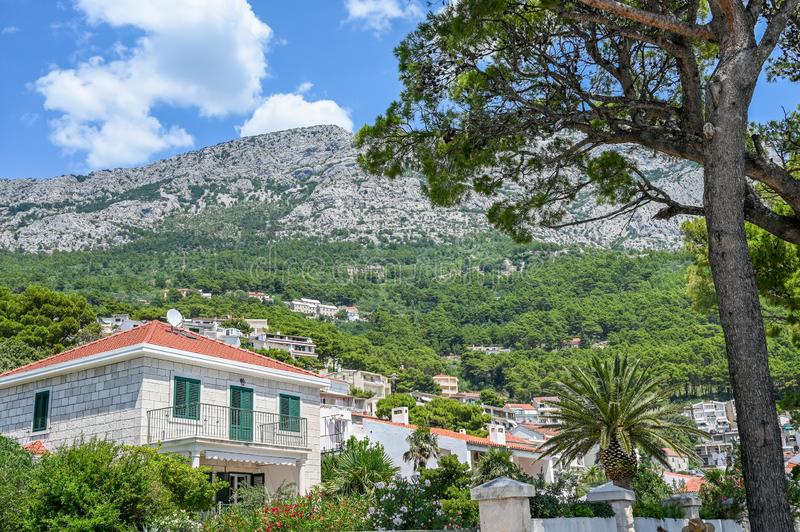 Brela, Croatia. July 19, 2019: Residential buildings in Brela. The location on the Makarska riviera in Croatia is famous for its beautiful pebbly beaches and stock photography