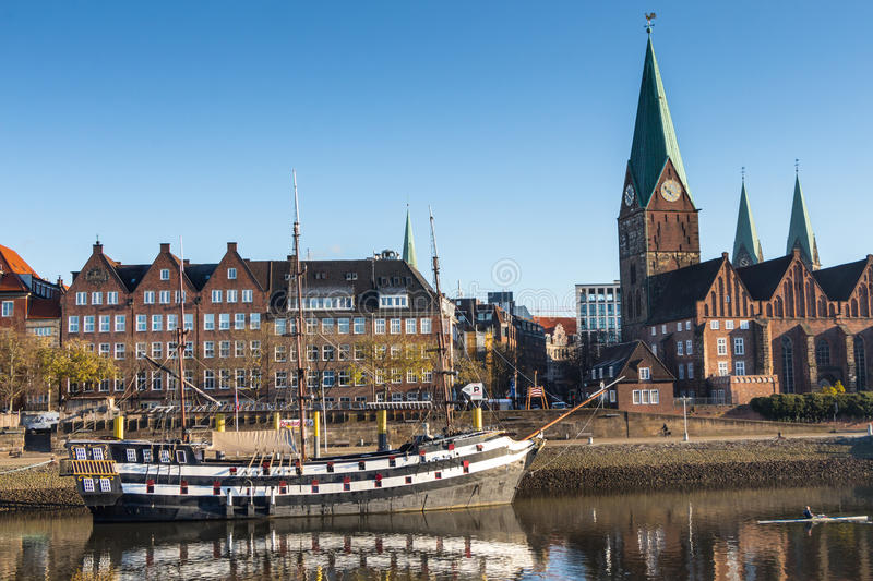 Bremen City. Bremen as seen from the river Weser with historic ship in the foreground royalty free stock photos