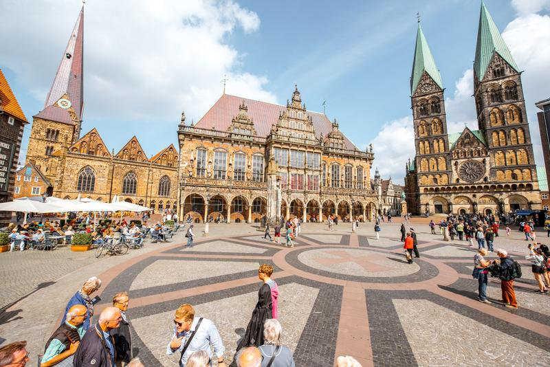Bremen city in Germany. BREMEN, GERMANY - August 09, 2017: View on the Market square full of tourists with beautiful city hall building and saint Peter cathedral stock photos