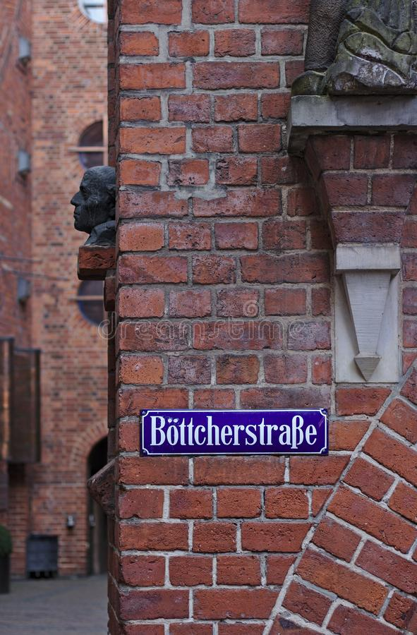Bremen, Germany - April 27th, 2018 - Street sign in Bremen`s most famous historic street, the Boettcherstrasse. Bremen, Germany - April 27th, 2018 - Blue and royalty free stock image