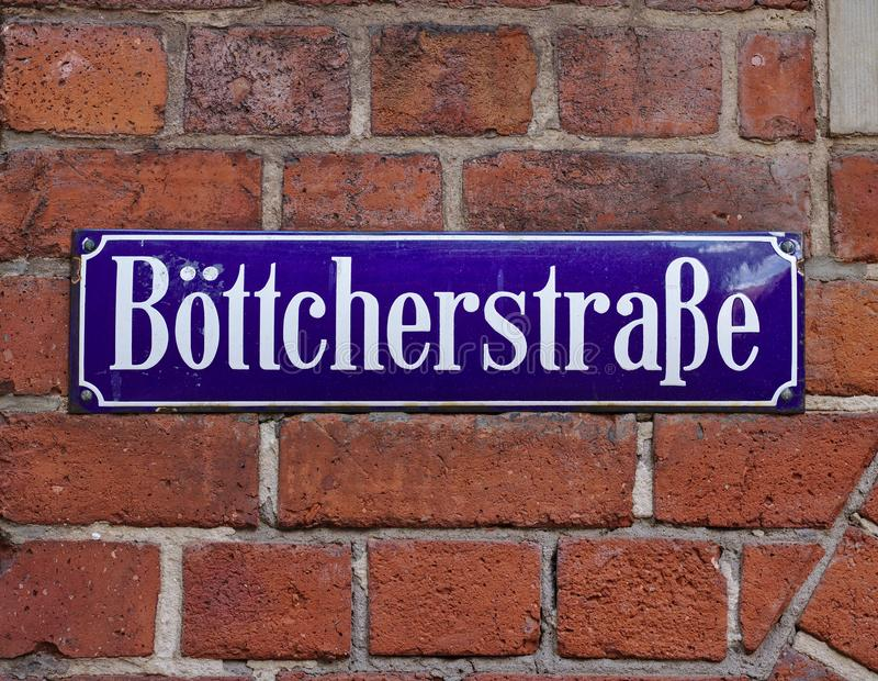 Bremen, Germany - April 27th, 2018 - Street sign in Bremen`s most famous historic street, the Boettcherstrasse. Bremen, Germany - April 27th, 2018 - Blue and stock image