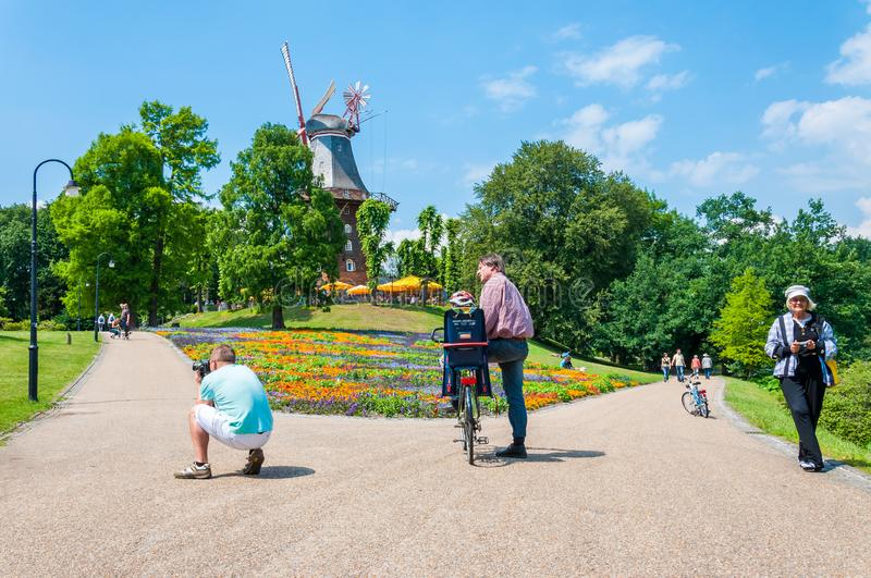 Summer actions in Wallanlagen Park in Bremen Germany. Tourists and locals spending time in this cozy vibrant park with famous stock photography