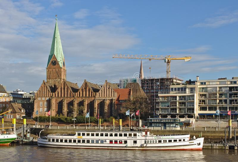Bremen, Germany - November 23rd, 2017 - Passenger vessel Oceana at her moorings in front of St Martini church royalty free stock photo