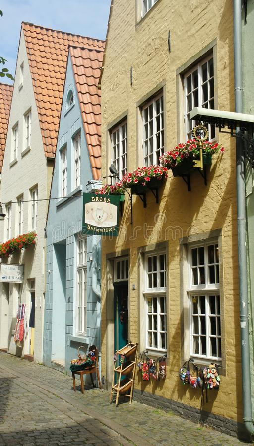 Bremen, Germany - 07/23/2015 - Picturesque view of medieval street Schnoor with half-timbered houses in the centre of the. Bremen, Germany - Picturesque view of stock photography