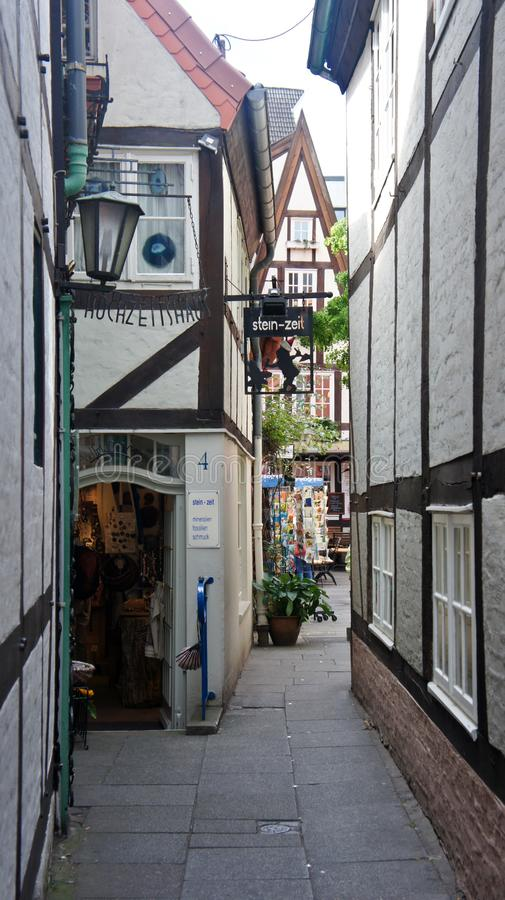 Bremen, Germany - 07/23/2015 - Scenic view of medieval narrow street in Schnoor, half-timbered houses in the centre of the. Bremen, Germany - Scenic view of stock photo