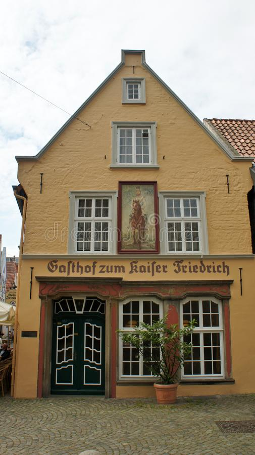 Bremen, Germany - 07/23/2015 - View of medieval street Schnoor with yellow house in the centre of the Hanseatic City, beautiful. Bremen, Germany - View of royalty free stock images