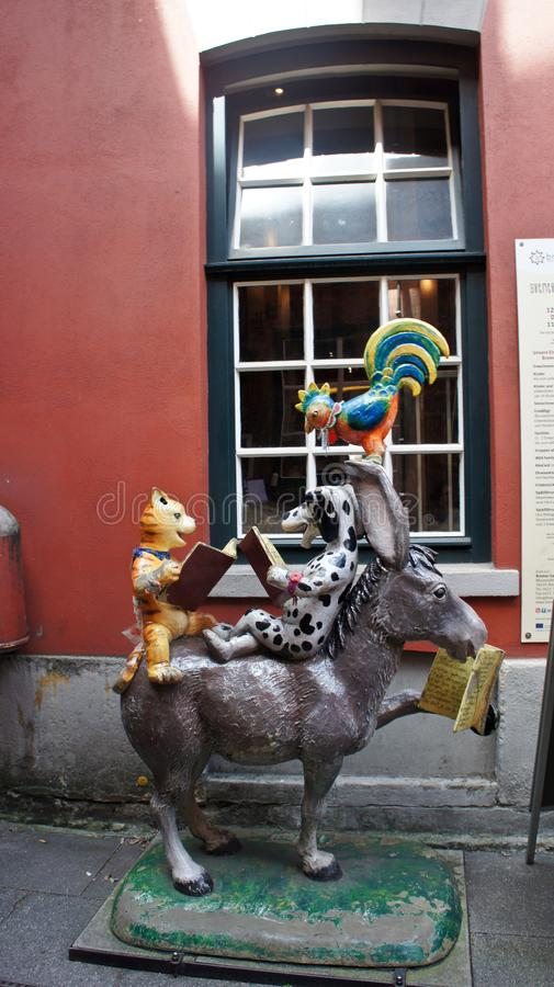 Bremen, Germany - 07/23/2015 - View of statue of the Town Musicians in medieval street Schnoor in the centre of the Hanseatic City. Bremen, Germany - View of stock images