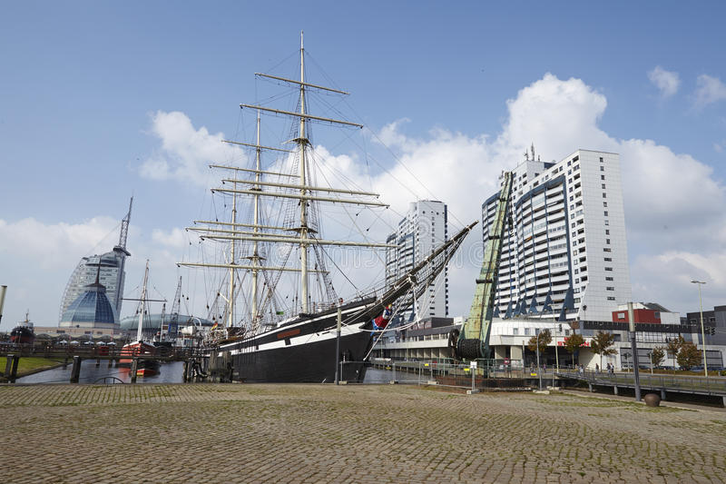 Bremerhaven (Germany) - Basin with historical ships and residential towers (retouched). The harbour basin with historical ships and residental towers at the stock photo