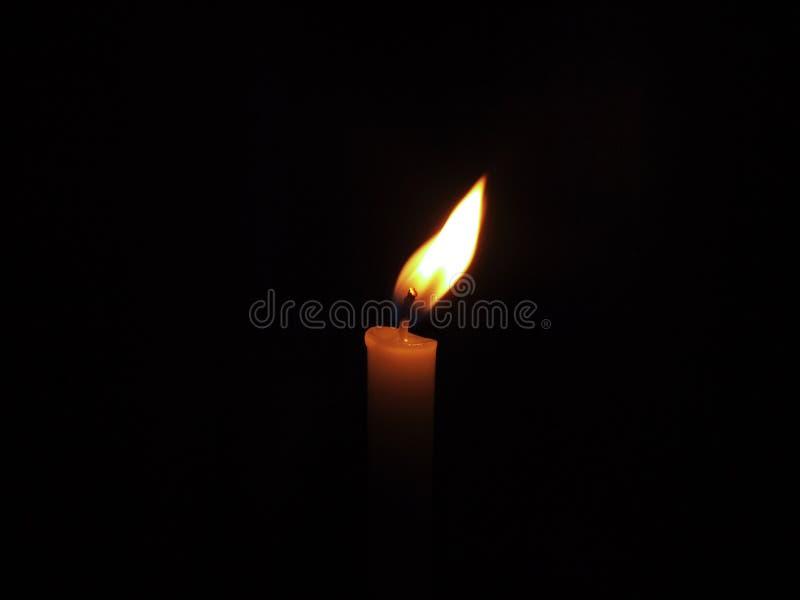 Brennende Kerze stockbild