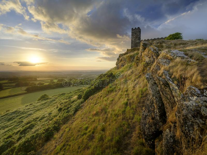 Brentor, with the church of St Michael de Rupe - St Michael of the Rock, on the edge of the Dartmoor National. Summer sunset over Brentor, with the church of St stock photo