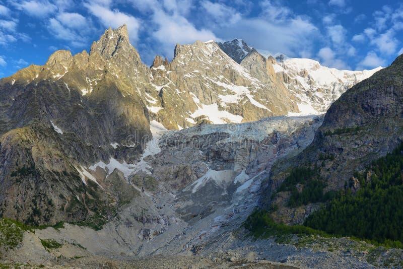 Brenva glacier and Aiguille noire de peuterey in Val Veny, Aosta valley, Italy. Brenva glacier and Aiguille noire de peuterey near Mont Blanc Skyway cable car royalty free stock photos
