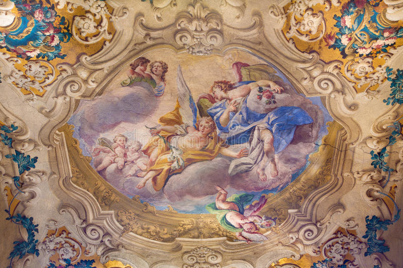BRESCIA, ITALY, 2016: The of angels with the flowers on cupola of side chapel in church Chiesa di San Giovanni Evangelista. BRESCIA, ITALY - MAY 23, 2016: The of stock photos