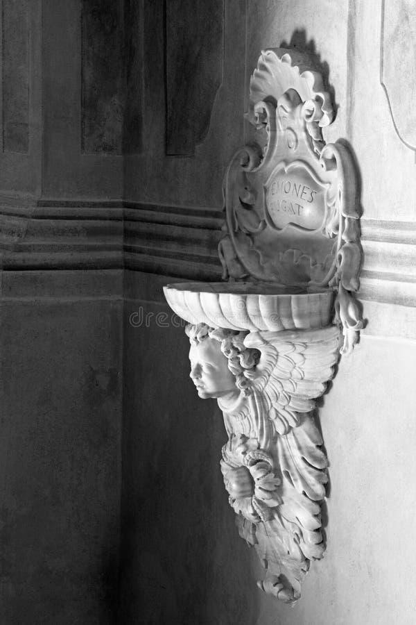 BRESCIA, ITALY, 2016: The baroque stoup in Chiesa di Santa Maria della Carita. BRESCIA, ITALY - MAY 21, 2016: The baroque stoup in Chiesa di Santa Maria della royalty free stock photo
