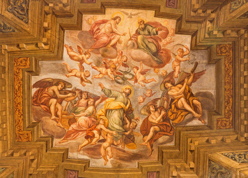 BRESCIA, ITALY, 2016: The ceiling fresco Coronation of Virgin Mary in church Chiesa di Santa Agata by Pompeo Ghitti. BRESCIA, ITALY - MAY 22, 2016: The ceiling stock photo