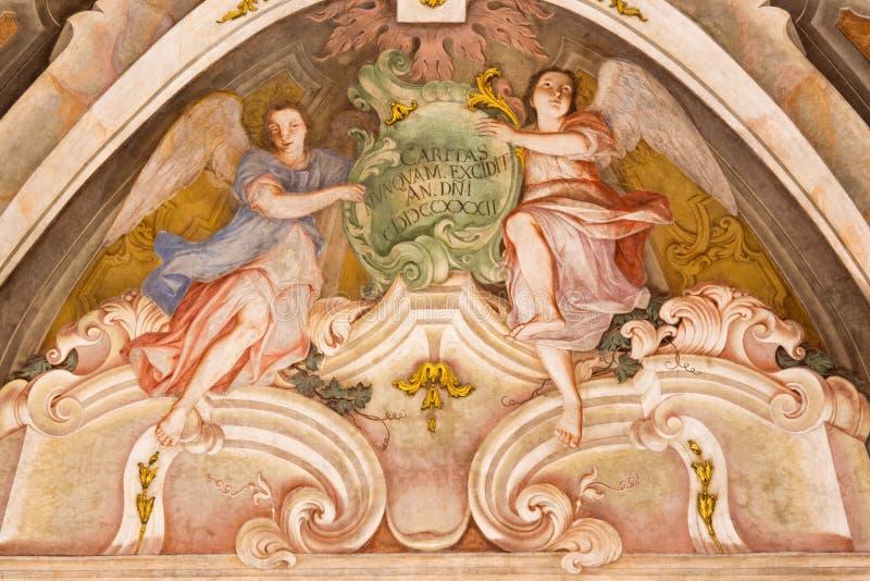 BRESCIA, ITALY, 2016: The fresco of cardinal virtue of Love in Chiesa di Santa Maria della Carita. BRESCIA, ITALY - MAY 21, 2016: The fresco of cardinal virtue royalty free stock image