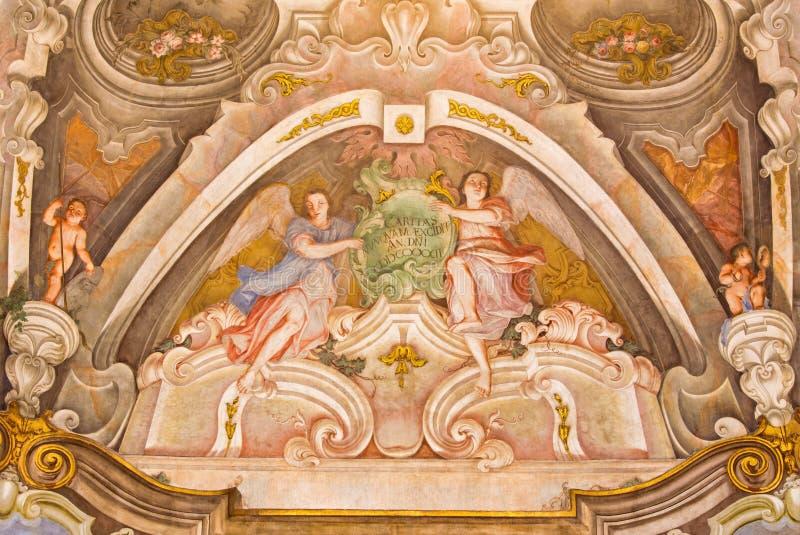 BRESCIA, ITALY, 2016: The fresco of cardinal virtue of Love in Chiesa di Santa Maria della Carita. BRESCIA, ITALY - MAY 21, 2016: The fresco of cardinal virtue stock photography
