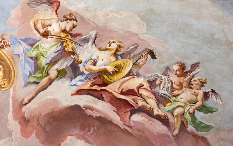 BRESCIA, ITALY: Fresco of choirs of angels on the cupola of presbytery of Chiesa di Sant'Afra church by Sante Cattaneo. BRESCIA, ITALY - MAY 23, 2016: The fresco royalty free stock photos
