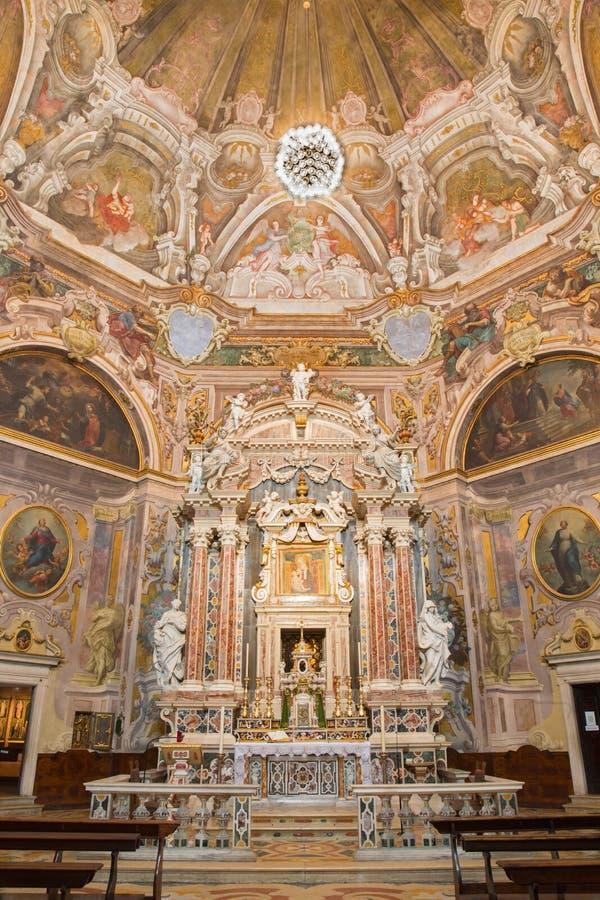 BRESCIA, ITALY, 2016: The main altar and the frescoes of cardinal virtues in Chiesa di Santa Maria della Carita. BRESCIA, ITALY - MAY 21, 2016: The main altar royalty free stock image