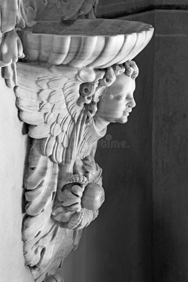 BRESCIA, ITALY - MAY 21, 2016: The baroque stoup in Chiesa di Santa Maria della Carita.  stock photo