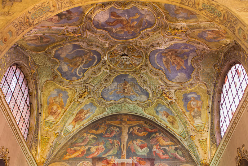 BRESCIA, ITALY - MAY 22, 2016: The ceiling baroque frescoes of side chapel and gothic-renaisscane fresco of Crucifixion. By Andrea Bembo 1475 in church Chiesa stock photo