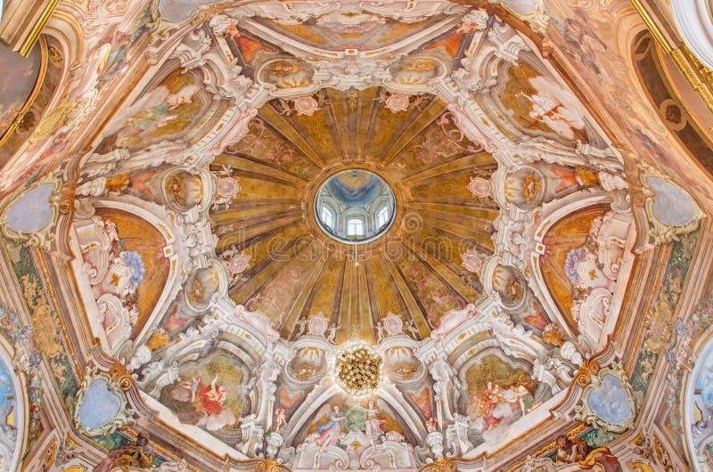 BRESCIA, ITALY - MAY 21, 2016: The fresco of cupola with the symbols of cardinal virtues in Chiesa di Santa Maria della Carita. By Ferdinando Cairo and Luigi stock photography